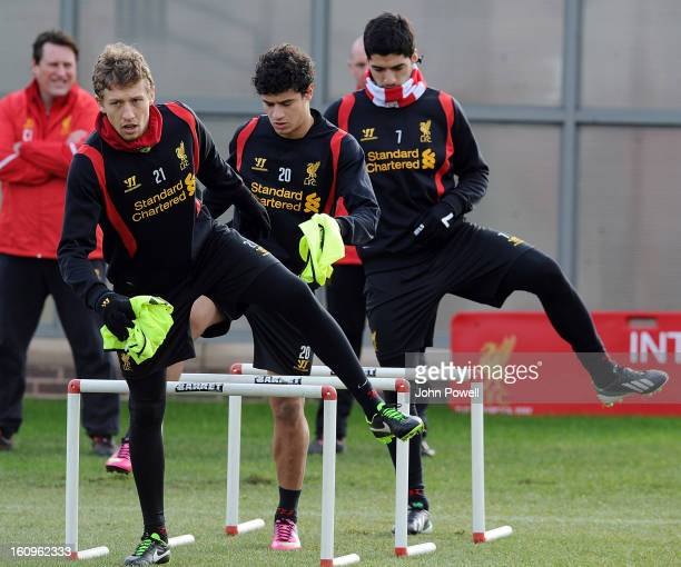 Philippe Coutinho Luis Suarez and Lucas Leiva of Liverpool in action during a training session at Melwood Training Ground on February 8 2013 in...