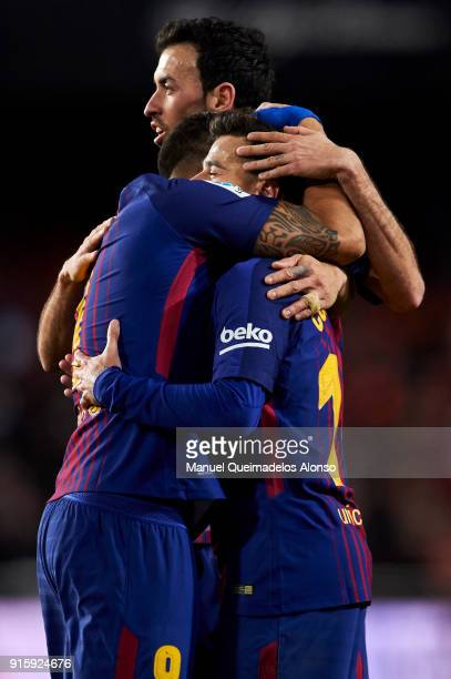 Philippe Coutinho' Luis Suarez and Sergio Busquets of FC Barcelona celebrate during the Copa de Rey semifinal second leg match between Valencia and...
