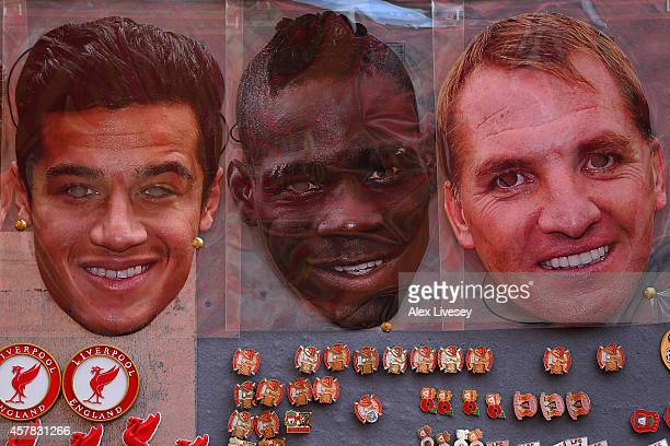 Philippe Coutinho Mario Balotelli and Brendan Rodgers face masks are displayed for sale at a stall outside the stadium before the Barclays Premier...