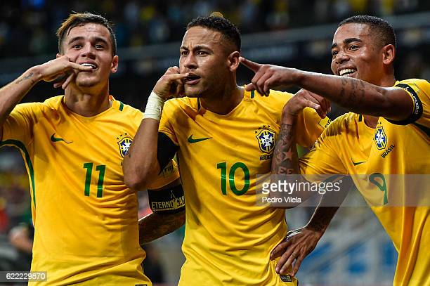 Philippe Coutinho Neymar and Gabriel Jesus of Brazil celebrates a scored goal against Argentina during a match between Brazil and Argentina as part...