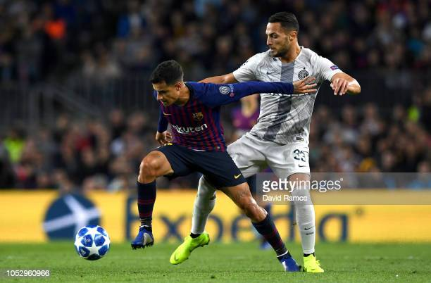 Philippe Coutinho of Barcelona battles for possession with Danilo D'Ambrosio of Inter Milan during the Group B match of the UEFA Champions League...