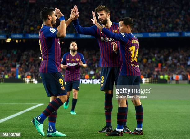 Philippe Coutinho of Barcelona celebrates after scoring his sides first goal with his teammates Gerard Pique and Luis Suarez during the La Liga match...