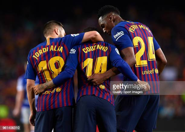 Philippe Coutinho of Barcelona celebrates after scoring his sides first goal with his teammates Jordi Alba and Yerry Mina during the La Liga match...