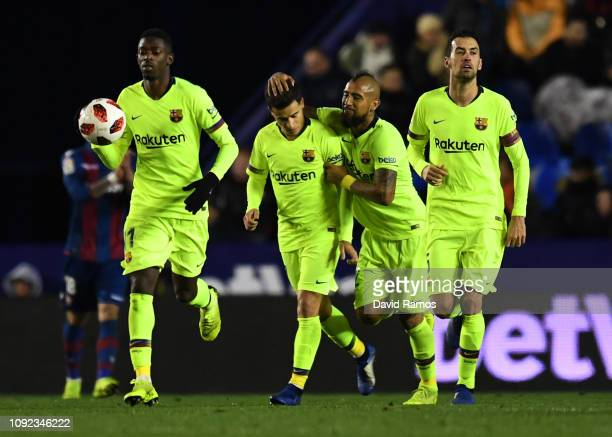 Philippe Coutinho of Barcelona celebrates after scoring his team's first goal with Ousmane Dembele , Arturo Vidal and Sergio Busquets during the Copa...