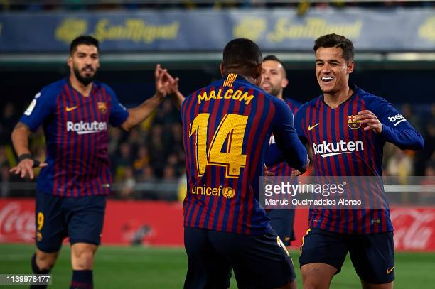 Philippe Coutinho of Barcelona celebrates after scoring his team's first goal with his teammate Malcom during the La Liga match between Villarreal CF...