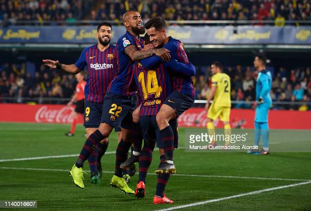 Philippe Coutinho of Barcelona celebrates after scoring his team's first goal with his teammates Malcom and Arturo Vidal during the La Liga match...