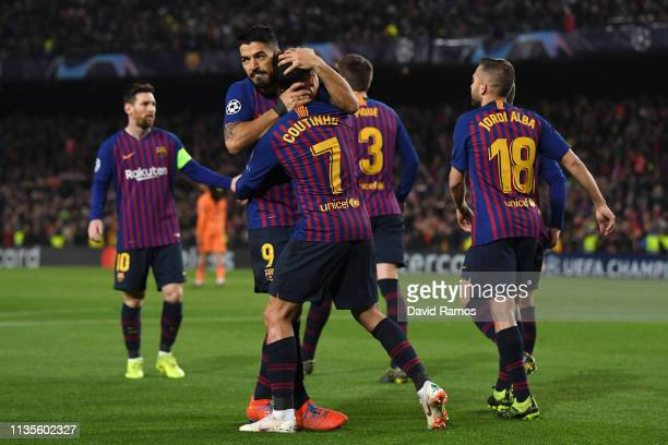 Philippe Coutinho of Barcelona celebrates as he scores his team's second goal with Luis Suarez and team mates during the UEFA Champions League Round...