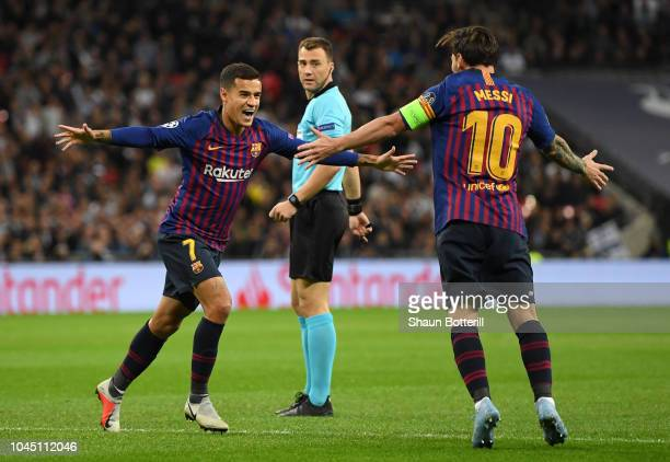 Philippe Coutinho of Barcelona celebrates with team mate Lionel Messi of Barcelona after scoring his team's first goal during the Group B match of...
