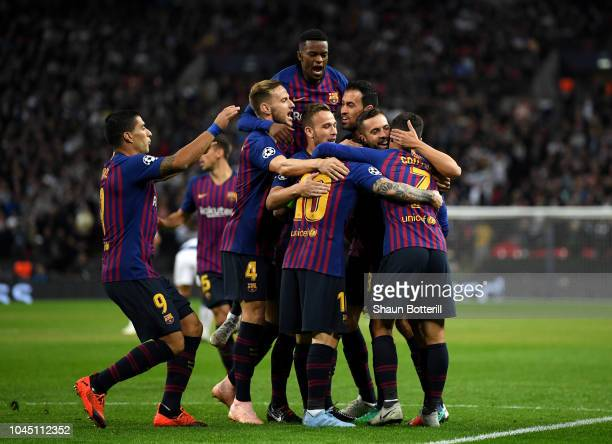 Philippe Coutinho of Barcelona celebrates with team mates after scoring his team's first goal during the Group B match of the UEFA Champions League...