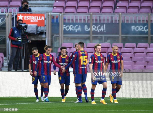 Philippe Coutinho of Barcelona celebrates with team mates Antoine Griezmann and Clement Lenglet after scoring their sides third goal during the La...