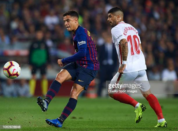 Philippe Coutinho of Barcelona competes for the ball with Ever Banega of Sevilla during the La Liga match between FC Barcelona and Sevilla FC at Camp...