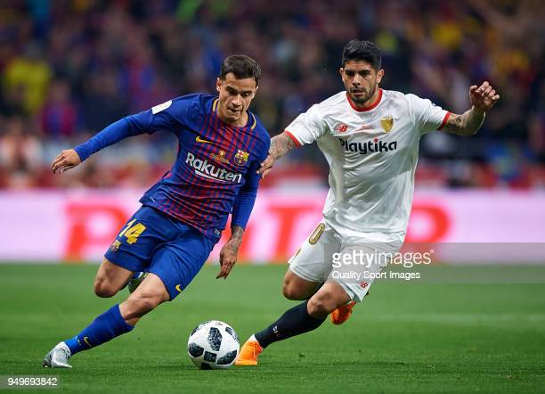Philippe Coutinho of Barcelona competes for the ball with Ever Banega of Sevilla during the Spanish Copa del Rey Final match between Barcelona and...