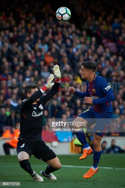 Philippe Coutinho of Barcelona competes for the ball with Kepa Arrizabalaga of Athletic Club during the La Liga match between Barcelona and Athletic...