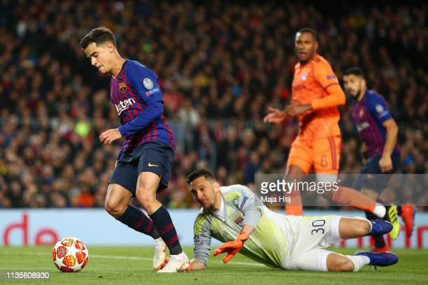Philippe Coutinho of Barcelona evades Mathieu Gorgelin of Olympique Lyonnais during the UEFA Champions League Round of 16 Second Leg match between FC...