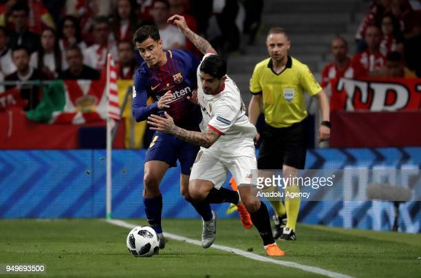 Philippe Coutinho of Barcelona in action against Ever Banega of Sevilla during Copa del Rey Final soccer match between Sevilla and Barcelona at Wanda...