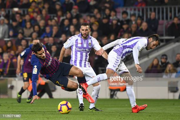 Philippe Coutinho of Barcelona is fouled by Kiko of Real Valladolid which leads to Barcelona being awarded a penalty during the La Liga match between...