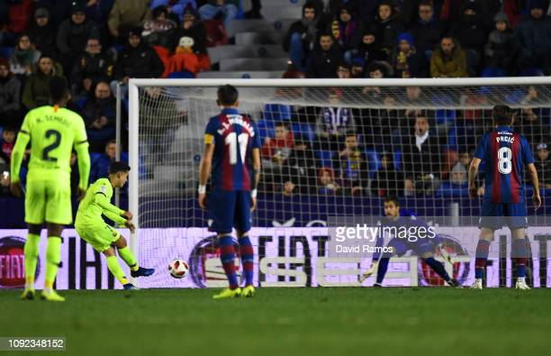 Philippe Coutinho of Barcelona scores team's first goal past Aitor Fernandez of Levante from a penalty during the Copa del Rey Round of 16 match...