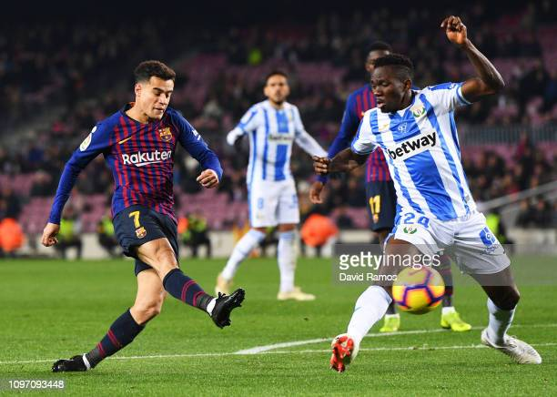 Philippe Coutinho of Barcelona shoots past Kenneth Omeruo of Leganes during the La Liga match between FC Barcelona and CD Leganes at Camp Nou on...