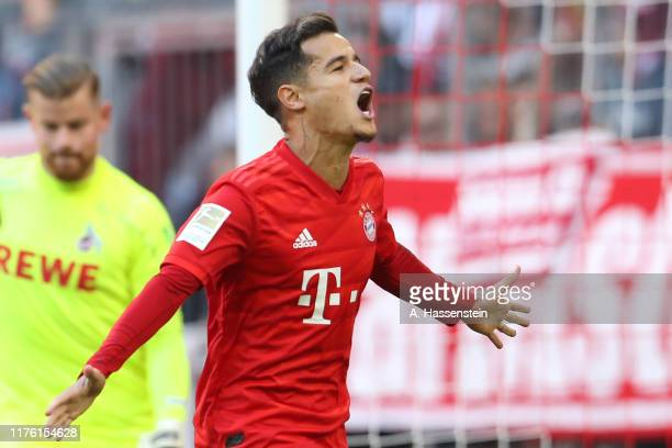 Philippe Coutinho of Bayern Muenchen celebrates scoring the 3rd team goal with a penalty during the Bundesliga match between FC Bayern Muenchen and...