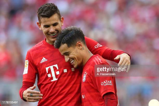 Philippe Coutinho of Bayern Muenchen celebrates scoring the 3rd team goal with his team mate K´Lucas Hernandez during the Bundesliga match between FC...