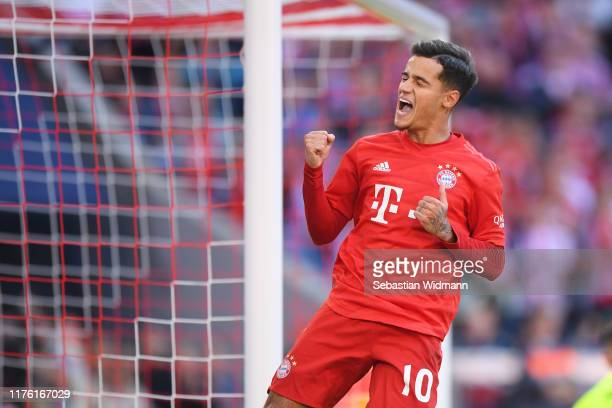 Philippe Coutinho of Bayern Munich celebrates scoring his team's third goal during the Bundesliga match between FC Bayern Muenchen and 1 FC Koeln at...