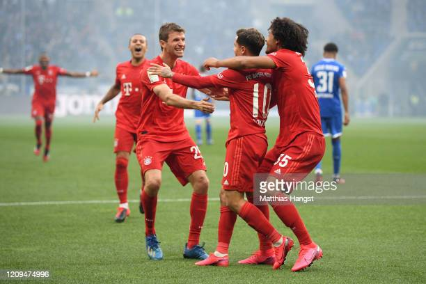 Philippe Coutinho of Bayern Munich celebrates with teammates Thomas Muller and Joshua Zirkzee after scoring his sides fifth goal during the...