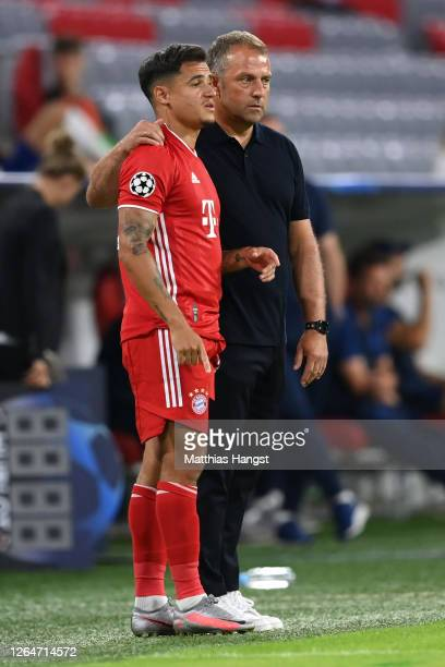 Philippe Coutinho of Bayern Munich speaks with HansDieter Flick Head Coach of Bayern Munich before he goes on the pitch during the UEFA Champions...