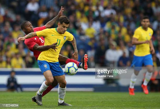 Philippe Coutinho of Brazil and FC Barcelona with Armando Cooper of Panama in action during the International Friendly match between Brazil and...