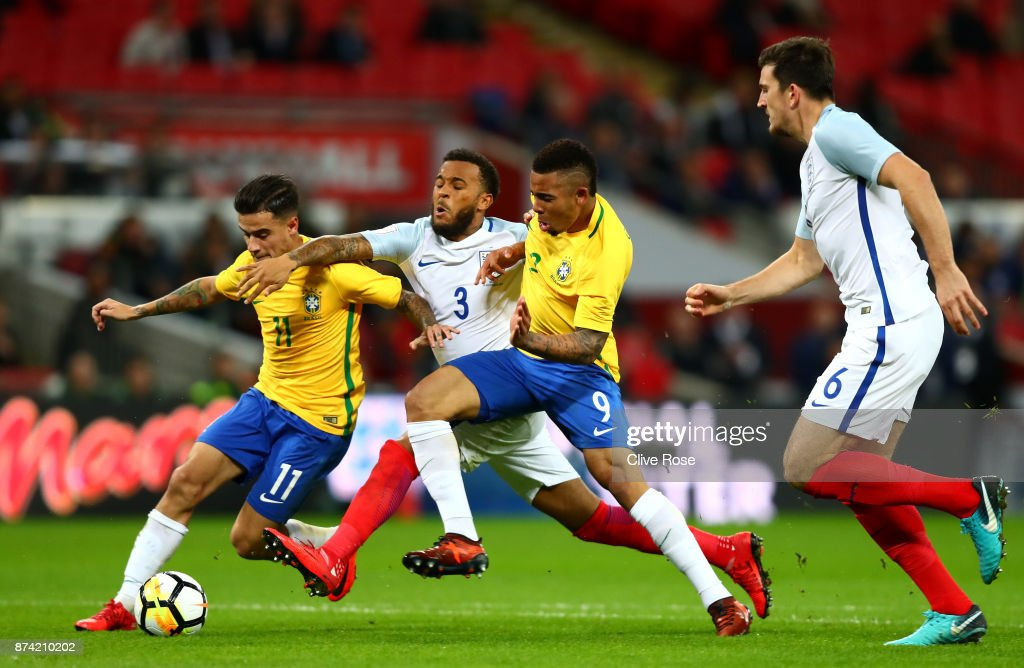 Philippe Coutinho of Brazil and Gabriel Jesus of Brazil battle for possession with Ryan Bertrand of England during the international friendly match between England and Brazil at Wembley Stadium on November 14, 2017 in London, England.