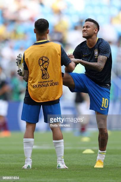Philippe Coutinho of Brazil and Neymar Jr of Brazil warm up prior to the 2018 FIFA World Cup Russia Round of 16 match between Brazil and Mexico at...