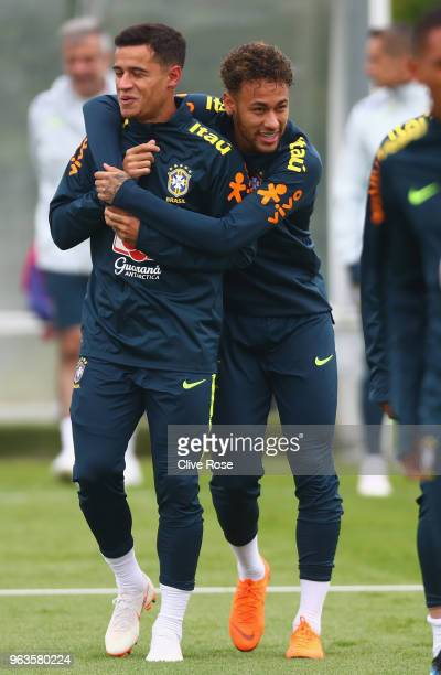 Philippe Coutinho of Brazil and Neymar of Brazil during a Brazil training session ahead of the international friendly between Brazil and Croatia at...