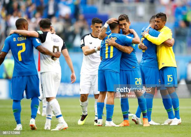 Philippe Coutinho of Brazil and Roberto Firmino of Brazil celebrate following their sides victory in the 2018 FIFA World Cup Russia group E match...