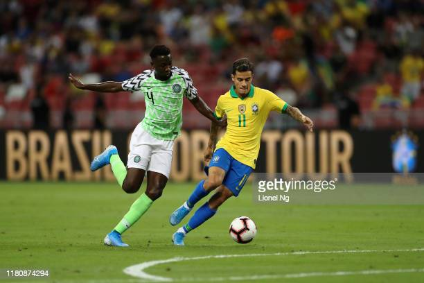Philippe Coutinho of Brazil and Wilfred Ndidi of Nigeria challenge for the ball during the international friendly match between Brazil and Nigeria at...