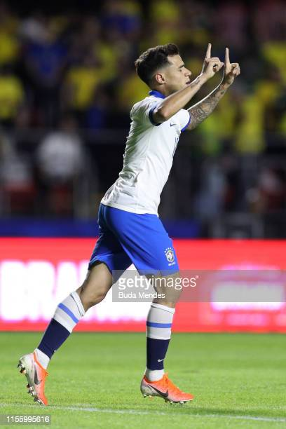 Philippe Coutinho of Brazil celebrates after scoring the opening goal via penalty during the Copa America Brazil 2019 group A match between Brazil...