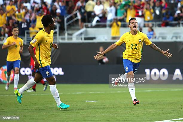 Philippe Coutinho of Brazil celebrates after scoring the opening goal during a group B match between Brazil and Haiti at Orlando Citrus Bowl as part...