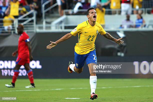 Philippe Coutinho of Brazil celebrates after scoring the second goal of his team during a group B match between Brazil and Haiti at Orlando Citrus...