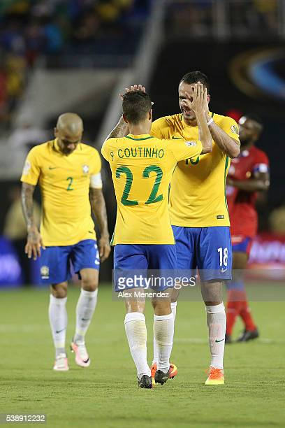 Philippe Coutinho of Brazil celebrates after scoring the seventh goal of his team with teammate Renato Augusto during a group B match between Brazil...