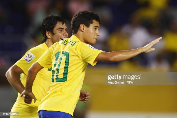 Philippe Coutinho of Brazil celebrates his team's second goal with team mate Henrique during the FIFA U-20 World Cup Group E match between Brazil and...