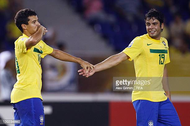 Philippe Coutinho of Brazil celebrates his team's second goal with team mate Henrique during the FIFA U20 World Cup Group E match between Brazil and...