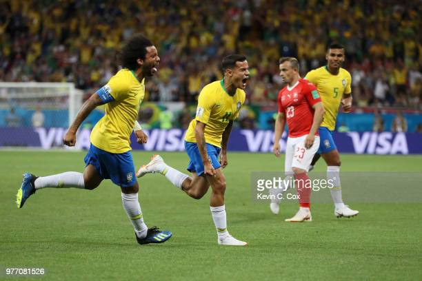 Philippe Coutinho of Brazil celebrates scoring the opening goal with Marcelo during the 2018 FIFA World Cup Russia group E match between Brazil and...