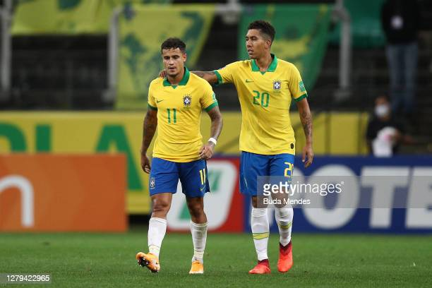 Philippe Coutinho of Brazil celebrates with Roberto Firmino after scoring the fifth goal during a match between Brazil and Bolivia as part of South...