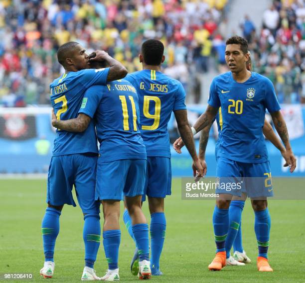 Philippe Coutinho of Brazil celebrates with teammate Douglas Costa after scoring his team's first goal during the 2018 FIFA World Cup Russia group E...