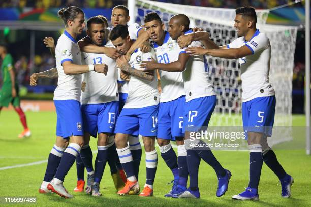 Philippe Coutinho of Brazil celebrates with teammates after scoring the second goal of his team during the Copa America Brazil 2019 group A match...