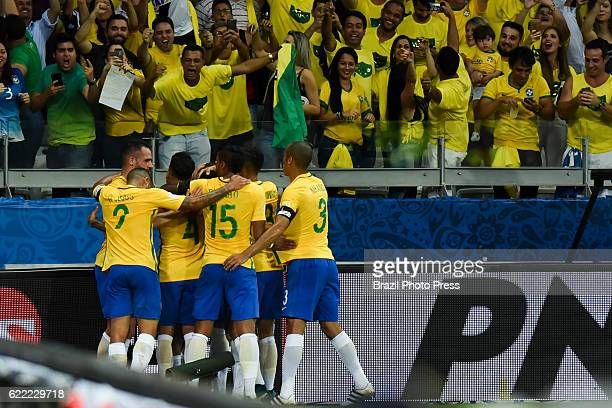 Philippe Coutinho of Brazil celebrates with teammates after scoring the opening goal during a match between Argentina and Brazil as part of FIFA 2018...