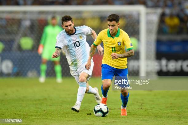 Philippe Coutinho of Brazil controls the ball against Lionel Messi of Argentina during the Copa America Brazil 2019 Semi Final match between Brazil...