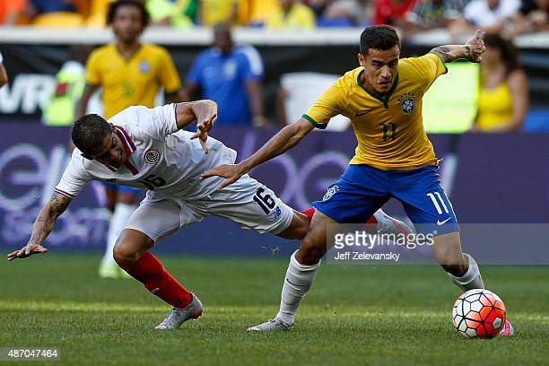 Philippe Coutinho of Brazil fights for the ball with Cristian Gamboa of Costa Rica during their match at Red Bull Arena on September 5 2015 in...