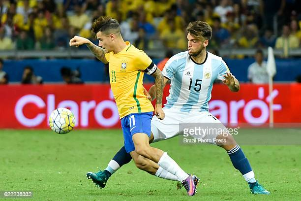 Philippe Coutinho of Brazil fights for the ball with Emmanuel Mas of Argentina during a match between Argentina and Brazil as part of FIFA 2018 World...