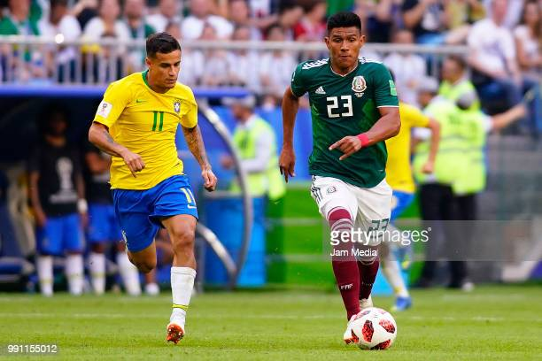 Philippe Coutinho of Brazil fights for the ball with Jesus Gallardo of Mexico during the 2018 FIFA World Cup Russia Round of 16 match between Brazil...