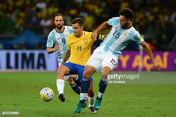 Philippe Coutinho of Brazil fights for the ball with of Emmanuel Mas of Argentina during a match between Argentina and Brazil as part of FIFA 2018...
