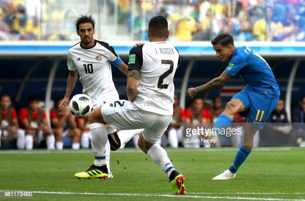 Philippe Coutinho of Brazil fires in a shot on goal past Bryan Ruiz and Johnny Acosta of Costa Rica during the 2018 FIFA World Cup Russia group E...